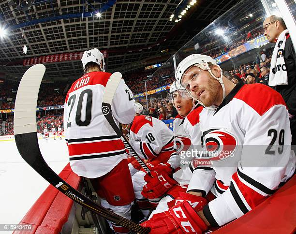 Bryan Bickell of the Carolina Hurricanes stretches at the bench during the game against the Calgary Flames at Scotiabank Saddledome on October 20...