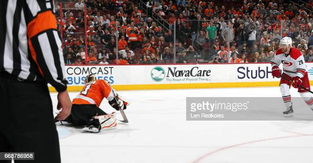 Bryan Bickell of the Carolina Hurricanes watches his shot on goal against Anthony Stolarz of the Philadelphia Flyers score during the shootout on...