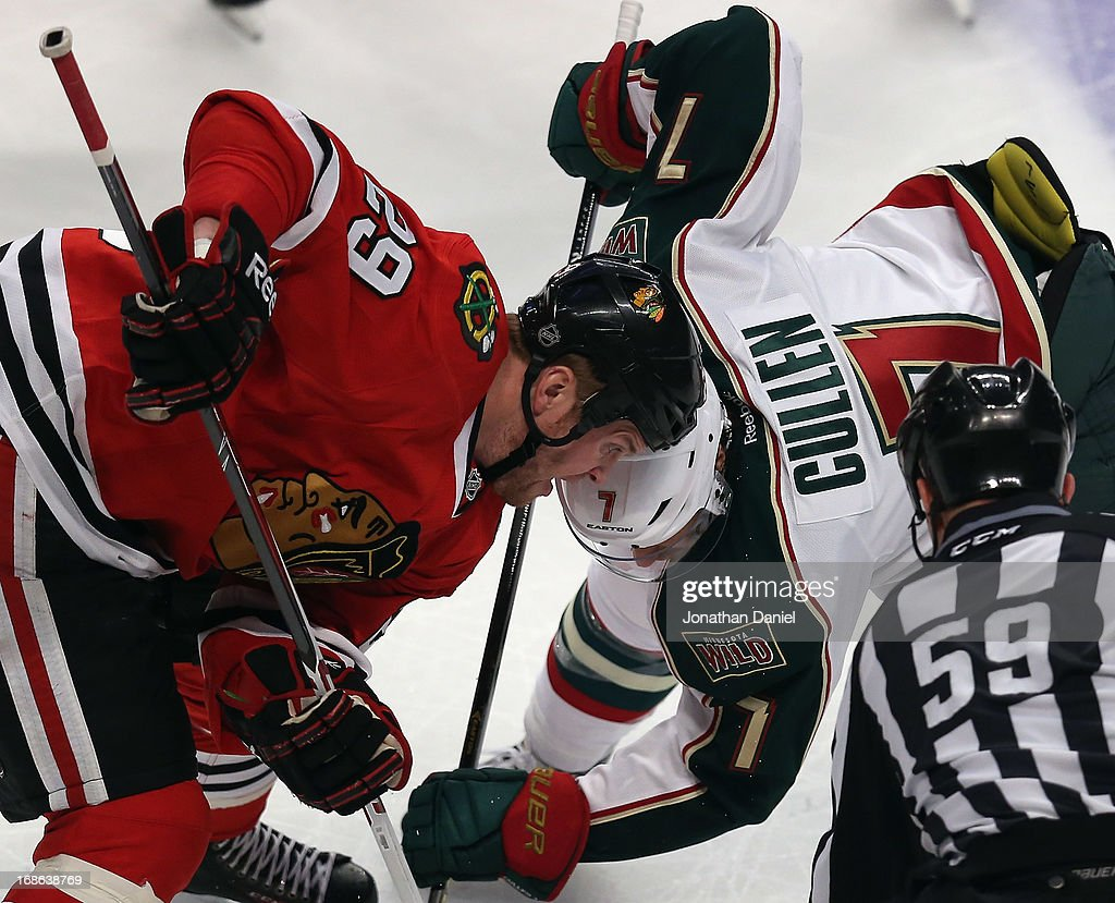 <a gi-track='captionPersonalityLinkClicked' href=/galleries/search?phrase=Bryan+Bickell&family=editorial&specificpeople=241498 ng-click='$event.stopPropagation()'>Bryan Bickell</a> #29 of the Chicago Blackhawks and <a gi-track='captionPersonalityLinkClicked' href=/galleries/search?phrase=Matt+Cullen&family=editorial&specificpeople=536122 ng-click='$event.stopPropagation()'>Matt Cullen</a> #7 of the Minnesota Wild wait for a face-off in Game Five of the Western Conference Quarterfinals during the 2013 NHL Stanley Cup Playoffs at the United Center on May 9, 2013 in Chicago, Illinois. The Blackhawks defeated the Wild 5-1 to win the series.