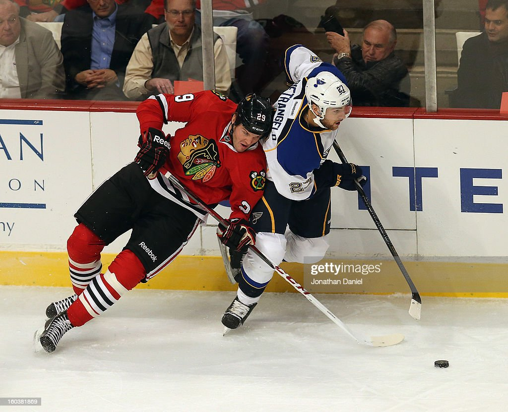 <a gi-track='captionPersonalityLinkClicked' href=/galleries/search?phrase=Bryan+Bickell&family=editorial&specificpeople=241498 ng-click='$event.stopPropagation()'>Bryan Bickell</a> #29 of the Chicago Blackhawks battles for the puck with <a gi-track='captionPersonalityLinkClicked' href=/galleries/search?phrase=Alex+Pietrangelo&family=editorial&specificpeople=4072229 ng-click='$event.stopPropagation()'>Alex Pietrangelo</a> #27 of the St. Louis Blues at the United Center on January 22, 2013 in Chicago, Illinois. The Blackhawks defeated the Blues 3-2.