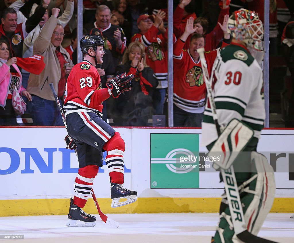<a gi-track='captionPersonalityLinkClicked' href=/galleries/search?phrase=Bryan+Bickell&family=editorial&specificpeople=241498 ng-click='$event.stopPropagation()'>Bryan Bickell</a> #29 of the Chicago Blackhawks celebrates a third period goal against <a gi-track='captionPersonalityLinkClicked' href=/galleries/search?phrase=Ilya+Bryzgalov&family=editorial&specificpeople=2285430 ng-click='$event.stopPropagation()'>Ilya Bryzgalov</a> #30 of the Minnesota Wild in Game Two of the Second Round of the 2014 NHL Stanley Cup Playoffs at the United Center on May 4, 2014 in Chicago, Illinois. The Blackhawks defeated the Wild 4-1.