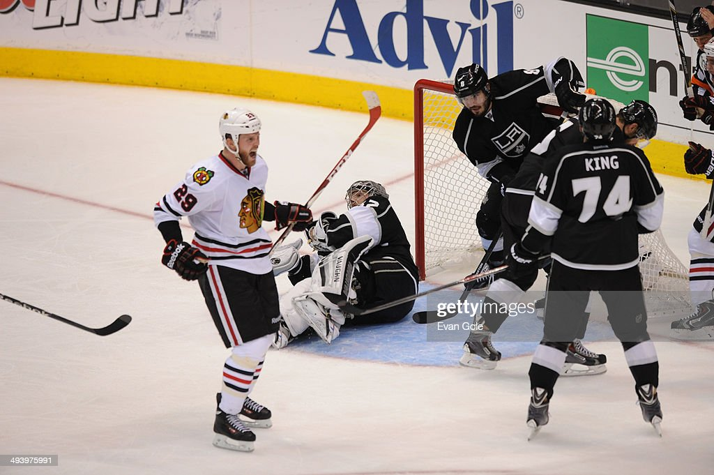 <a gi-track='captionPersonalityLinkClicked' href=/galleries/search?phrase=Bryan+Bickell&family=editorial&specificpeople=241498 ng-click='$event.stopPropagation()'>Bryan Bickell</a> #29 of the Chicago Blackhawks celebrates after scoring a goal against <a gi-track='captionPersonalityLinkClicked' href=/galleries/search?phrase=Jonathan+Quick&family=editorial&specificpeople=2271852 ng-click='$event.stopPropagation()'>Jonathan Quick</a> #32 of the Los Angeles Kings in Game Four of the Western Conference Final during the 2014 Stanley Cup Playoffs at Staples Center on May 26, 2014 in Los Angeles, California.