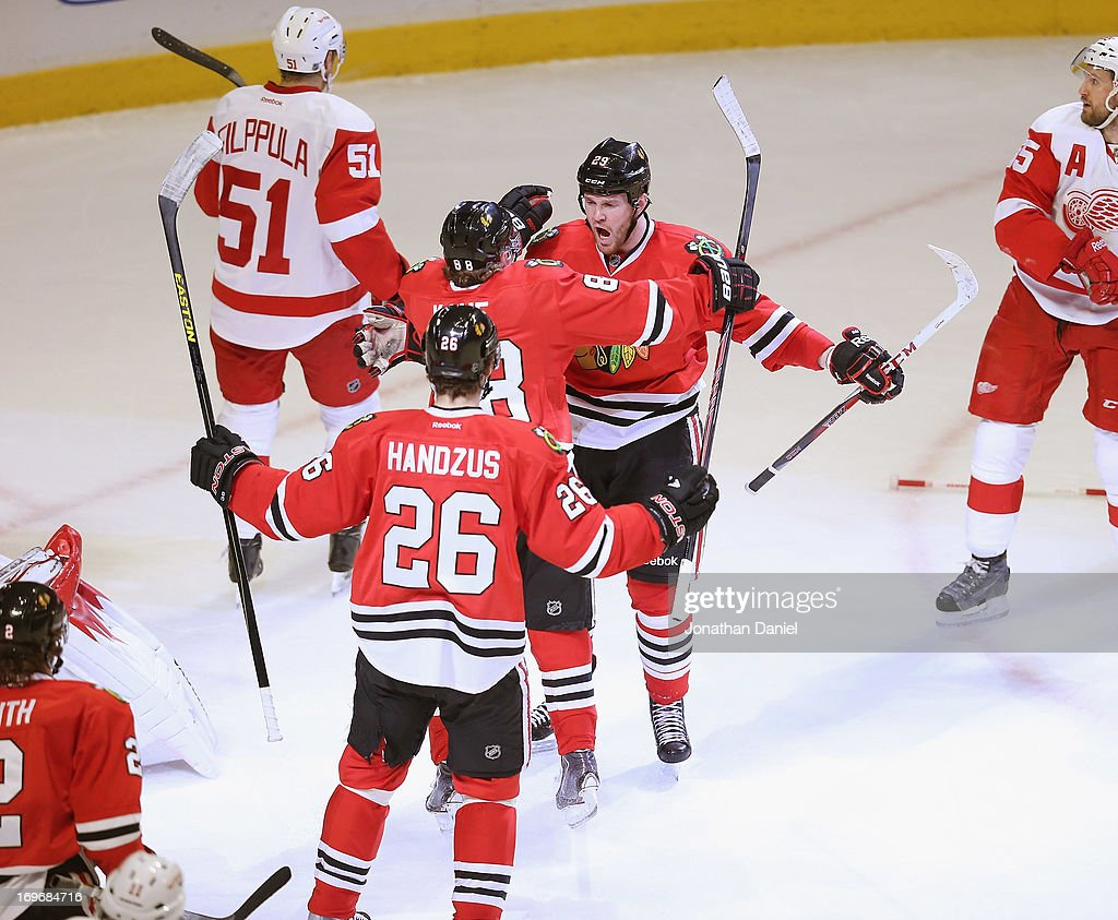 <a gi-track='captionPersonalityLinkClicked' href=/galleries/search?phrase=Bryan+Bickell&family=editorial&specificpeople=241498 ng-click='$event.stopPropagation()'>Bryan Bickell</a> #29 of the Chicago Blackhawks celebrates his first period goal with Patrick Kane #88 and <a gi-track='captionPersonalityLinkClicked' href=/galleries/search?phrase=Michal+Handzus&family=editorial&specificpeople=201537 ng-click='$event.stopPropagation()'>Michal Handzus</a> #26 against the Detroit Red Wings in Game Five of the Western Conference Semifinals during the 2013 NHL Stanley Cup Playoffs at the United Center on May 25, 2013 in Chicago, Illinois. The Blackhawks defeated the Red Wings 4-1.