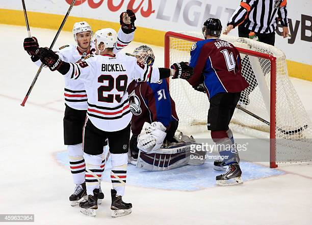 Bryan Bickell of the Chicago Blackhawks celebrates his goal against goalie Calvin Pickard of the Colorado Avalanche with teammate Jonathan Toews of...