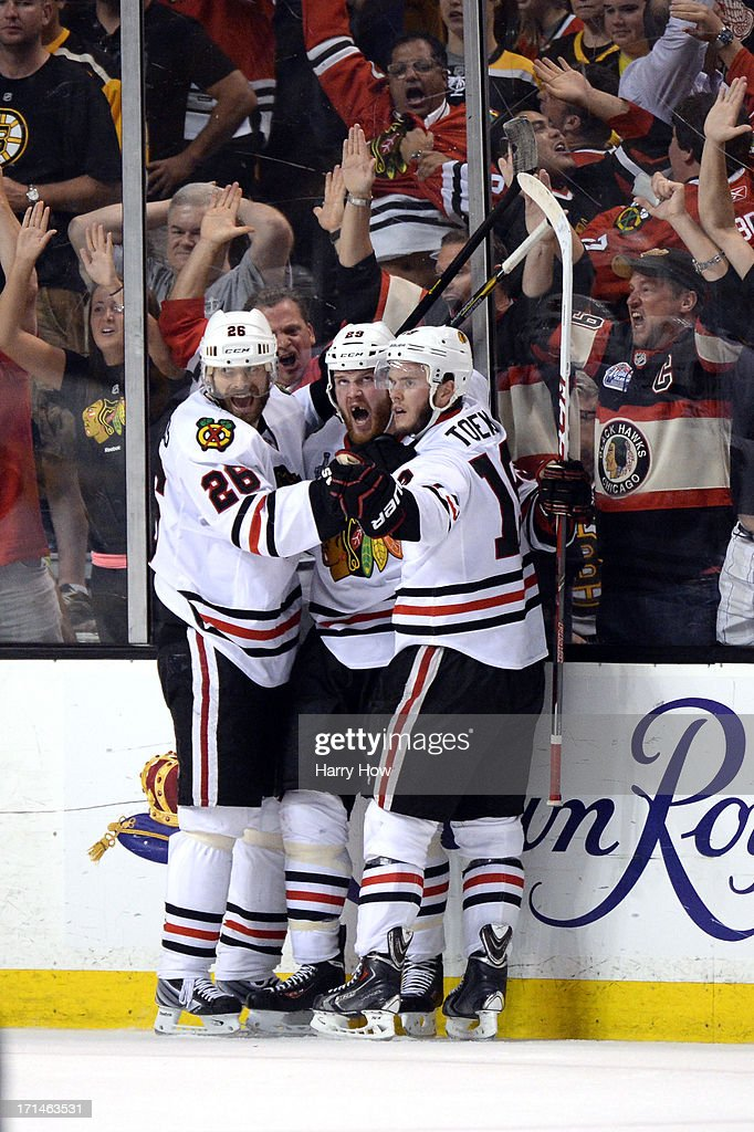 Bryan Bickell #29 of the Chicago Blackhawks celebrates with teammates after scoring a goal in the third period against the Boston Bruins in Game Six of the 2013 NHL Stanley Cup Final at TD Garden on June 24, 2013 in Boston, Massachusetts.