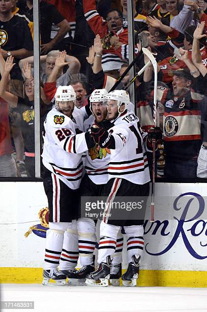 Bryan Bickell of the Chicago Blackhawks celebrates with teammates after scoring a goal in the third period against the Boston Bruins in Game Six of...