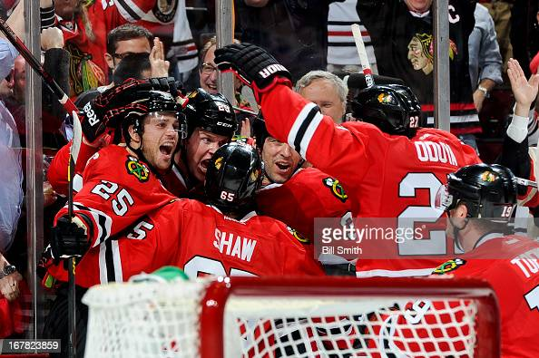 Bryan Bickell of the Chicago Blackhawks celebrates with teammates including Viktor Stalberg and Michal Rozsival after scoring the game winning goal...