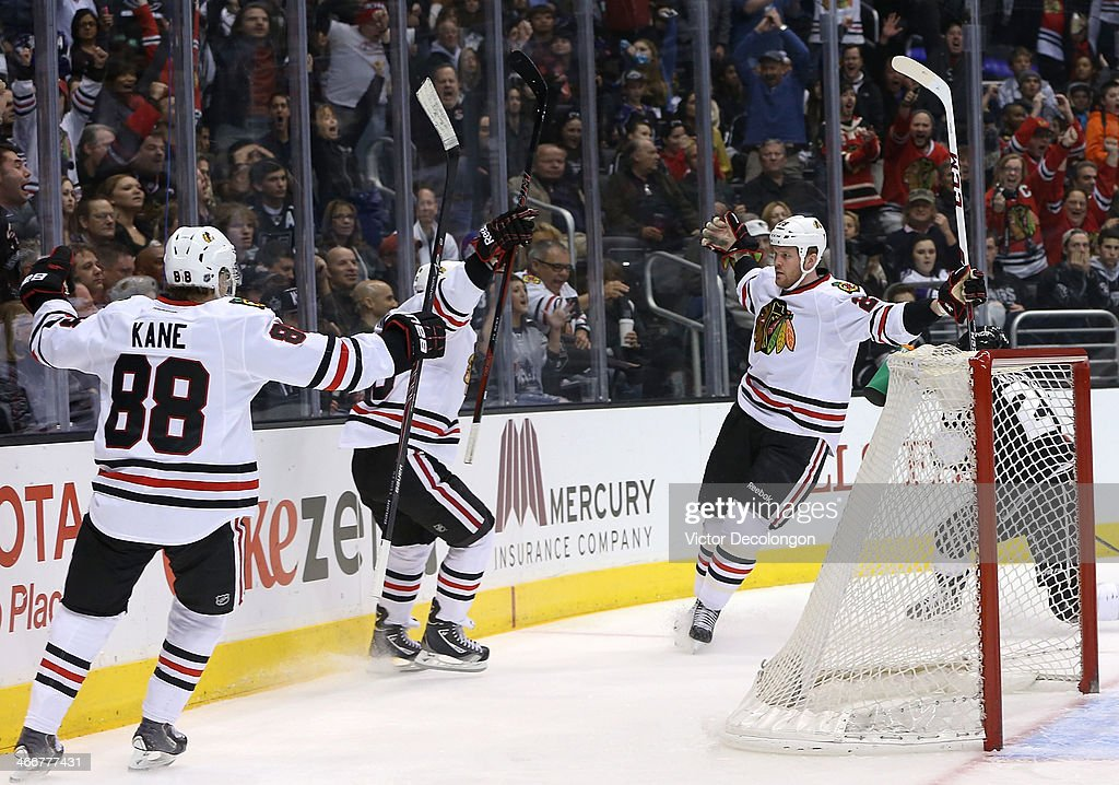 <a gi-track='captionPersonalityLinkClicked' href=/galleries/search?phrase=Bryan+Bickell&family=editorial&specificpeople=241498 ng-click='$event.stopPropagation()'>Bryan Bickell</a> #29 of the Chicago Blackhawks celebreates his first period goal with teammates Patrick Kane #88 and Andrew Shaw #65 against the Los Angeles Kings in the first period of their NHL game at Staples Center on February 3, 2014 in Los Angeles, California. The Blackhawks defeated the Kings 5-3.