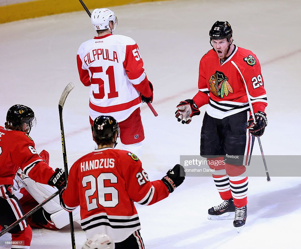 <a gi-track='captionPersonalityLinkClicked' href=/galleries/search?phrase=Bryan+Bickell&family=editorial&specificpeople=241498 ng-click='$event.stopPropagation()'>Bryan Bickell</a> #29 of the Chicago Blackhawks celebtrates his first period goal with Patrick Kane #88 and <a gi-track='captionPersonalityLinkClicked' href=/galleries/search?phrase=Michal+Handzus&family=editorial&specificpeople=201537 ng-click='$event.stopPropagation()'>Michal Handzus</a> #26 against the Detroit Red Wings in Game Five of the Western Conference Semifinals during the 2013 NHL Stanley Cup Playoffs at the United Center on May 25, 2013 in Chicago, Illinois.