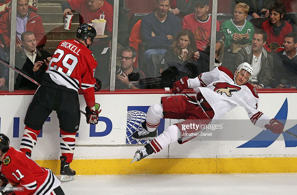 <a gi-track='captionPersonalityLinkClicked' href=/galleries/search?phrase=Bryan+Bickell&family=editorial&specificpeople=241498 ng-click='$event.stopPropagation()'>Bryan Bickell</a> #29 of the Chicago Blackhawks checks <a gi-track='captionPersonalityLinkClicked' href=/galleries/search?phrase=Jeff+Halpern&family=editorial&specificpeople=206583 ng-click='$event.stopPropagation()'>Jeff Halpern</a> #14 f the Phoenix Coyotes at the United Center on November 14, 2013 in Chicago, Illinois.