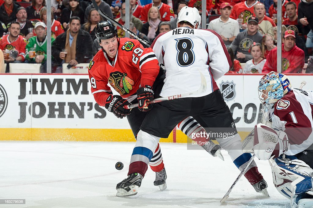 Bryan Bickell #29 of the Chicago Blackhawks collides with Jan Hejda #8 of the Colorado Avalanche during the NHL game on March 06, 2013 at the United Center in Chicago, Illinois.