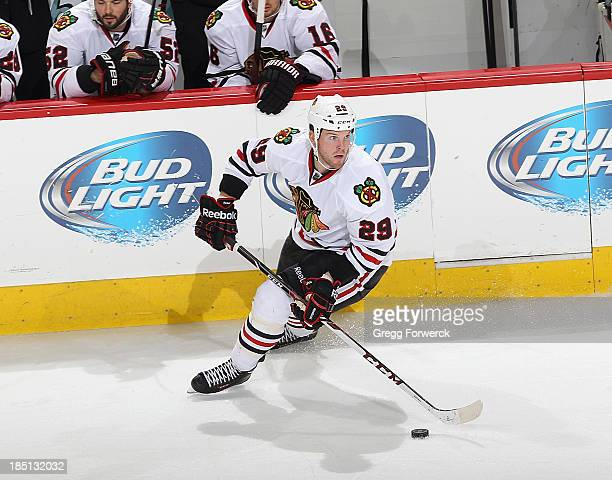 Bryan Bickell of the Chicago Blackhawks controls the puck along the boards during their NHL game against the Carolina Hurricanes at PNC Arena on...