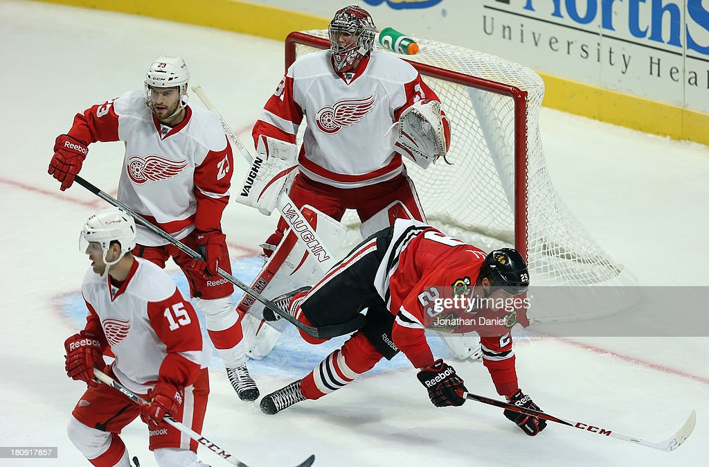 <a gi-track='captionPersonalityLinkClicked' href=/galleries/search?phrase=Bryan+Bickell&family=editorial&specificpeople=241498 ng-click='$event.stopPropagation()'>Bryan Bickell</a> #29 of the Chicago Blackhawks hitds the ice after being shoved by <a gi-track='captionPersonalityLinkClicked' href=/galleries/search?phrase=Brian+Lashoff&family=editorial&specificpeople=5529056 ng-click='$event.stopPropagation()'>Brian Lashoff</a> #23 of the Detroit Red Wings during an exhibition game at United Center on September 17, 2013 in Chicago, Illinois. The Blackhawks defeated the Red Wings 2-0.