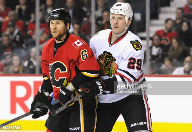 Bryan Bickell of the Chicago Blackhawks plays in the game against Dennis Wideman of the Calgary Flames at Scotiabank Saddledome on November 20 2014...