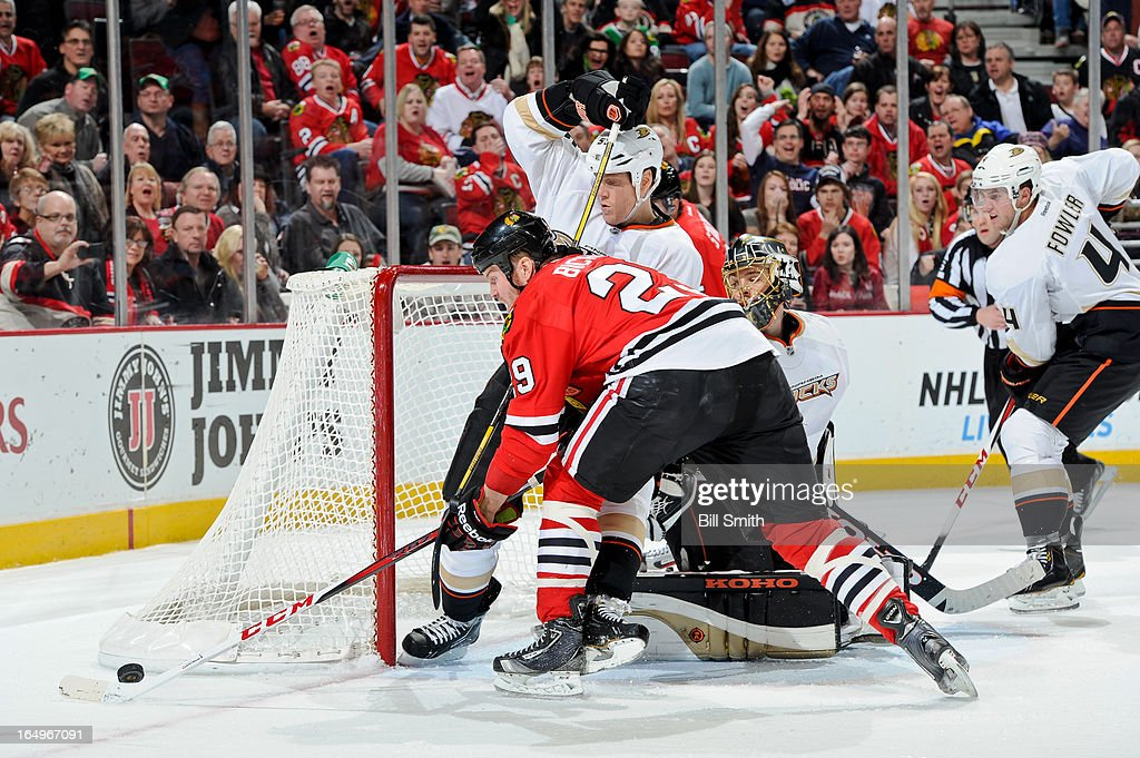<a gi-track='captionPersonalityLinkClicked' href=/galleries/search?phrase=Bryan+Bickell&family=editorial&specificpeople=241498 ng-click='$event.stopPropagation()'>Bryan Bickell</a> #29 of the Chicago Blackhawks reaches for the puck across <a gi-track='captionPersonalityLinkClicked' href=/galleries/search?phrase=Bryan+Allen+-+Ice+Hockey+Player&family=editorial&specificpeople=206454 ng-click='$event.stopPropagation()'>Bryan Allen</a> #55 of the Anaheim Ducks, as they stand next to Ducks goalie <a gi-track='captionPersonalityLinkClicked' href=/galleries/search?phrase=Jonas+Hiller&family=editorial&specificpeople=743364 ng-click='$event.stopPropagation()'>Jonas Hiller</a> #1 and <a gi-track='captionPersonalityLinkClicked' href=/galleries/search?phrase=Cam+Fowler&family=editorial&specificpeople=5484080 ng-click='$event.stopPropagation()'>Cam Fowler</a> #4 of the Ducks watches in the background, during the NHL game on March 29, 2013 at the United Center in Chicago, Illinois.