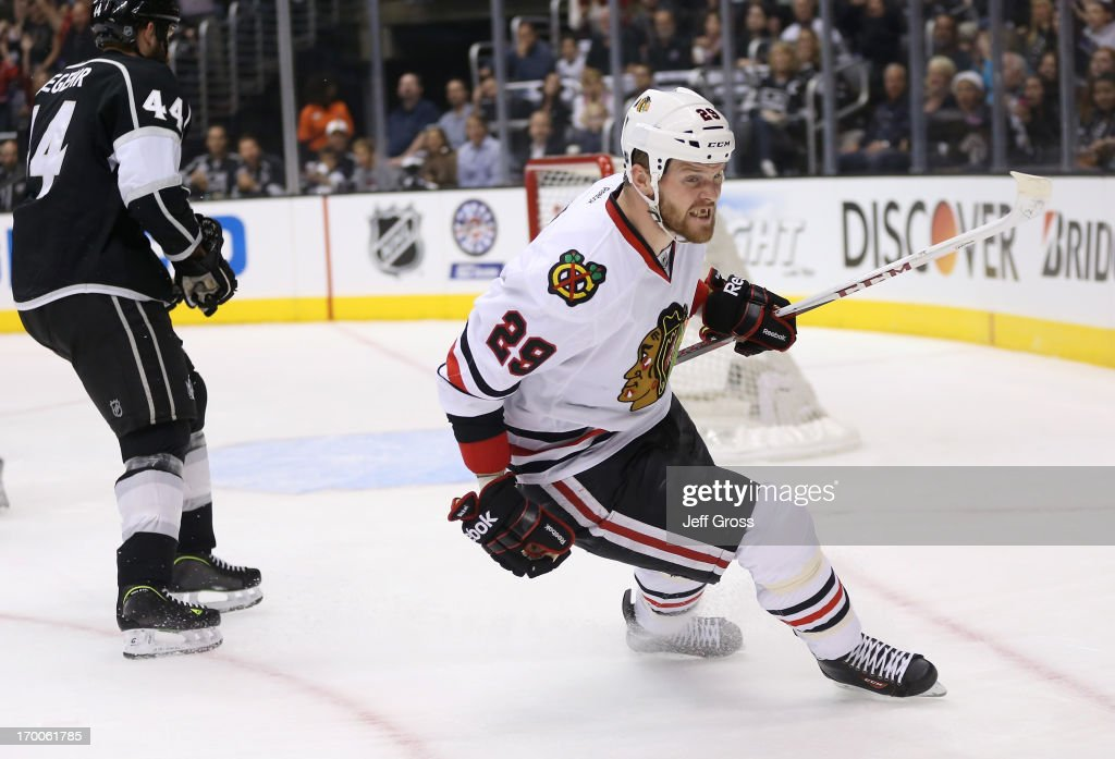 <a gi-track='captionPersonalityLinkClicked' href=/galleries/search?phrase=Bryan+Bickell&family=editorial&specificpeople=241498 ng-click='$event.stopPropagation()'>Bryan Bickell</a> #29 of the Chicago Blackhawks reacts after scoring a goal in the first period of Game Four of the Western Conference Final against the Los Angeles Kings during the 2013 NHL Stanley Cup Playoffs at Staples Center on June 6, 2013 in Los Angeles, California. Bickell scored on the shot.