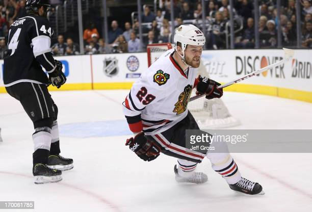 Bryan Bickell of the Chicago Blackhawks reacts after scoring a goal in the first period of Game Four of the Western Conference Final against the Los...