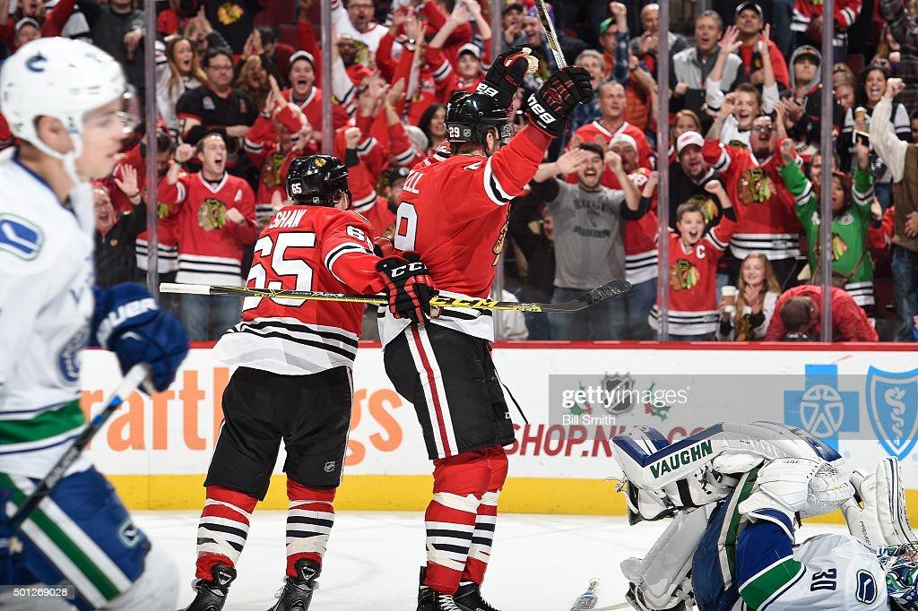 <a gi-track='captionPersonalityLinkClicked' href=/galleries/search?phrase=Bryan+Bickell&family=editorial&specificpeople=241498 ng-click='$event.stopPropagation()'>Bryan Bickell</a> #29 of the Chicago Blackhawks reacts after the Blackhawks scored against the Vancouver Canucks in the third period of the NHL game at the United Center on December 13, 2015 in Chicago, Illinois.