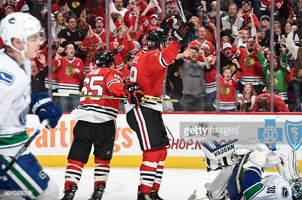 Bryan Bickell of the Chicago Blackhawks reacts after the Blackhawks scored against the Vancouver Canucks in the third period of the NHL game at the...