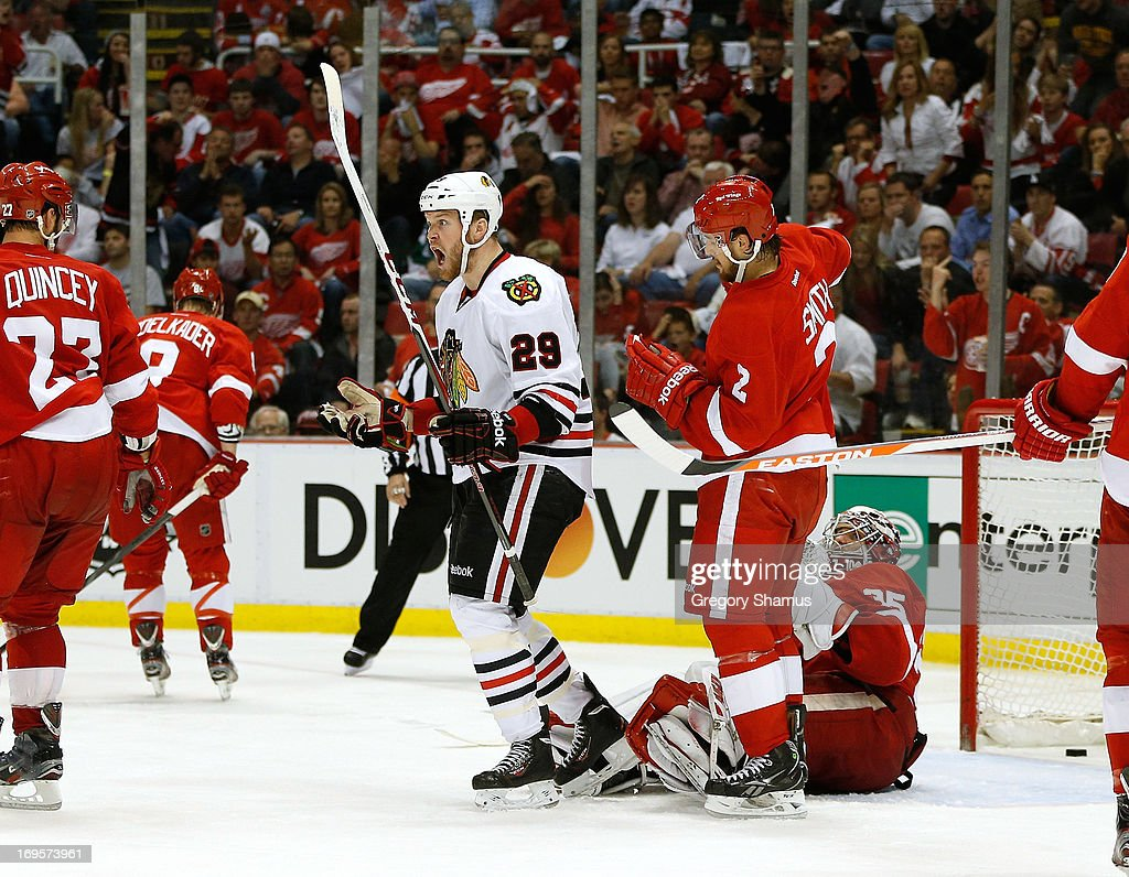 Bryan Bickell #29 of the Chicago Blackhawks reacts to his third period goal in front of Jimmy Howard #35 and Brendan Smith #2 of the Detroit Red Wings in Game Six of the Western Conference Semifinals during the 2013 NHL Stanley Cup Playoffs at Joe Louis Arena on May 27, 2013 in Detroit, Michigan. Chicago won the game 4-3 to tie the series 3-3.