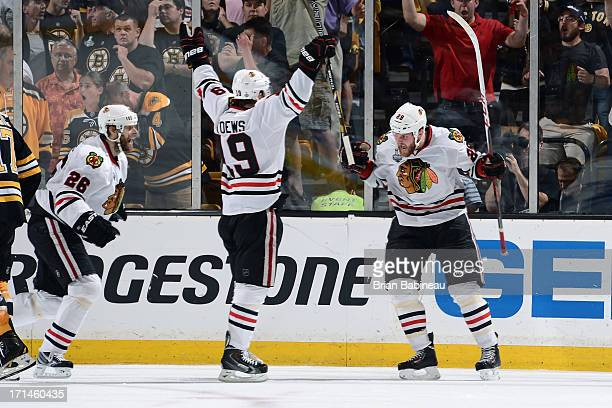 Bryan Bickell of the Chicago Blackhawks scores a goal against the Boston Bruins in Game Six of the Stanley Cup Final at TD Garden on June 24 2013 in...