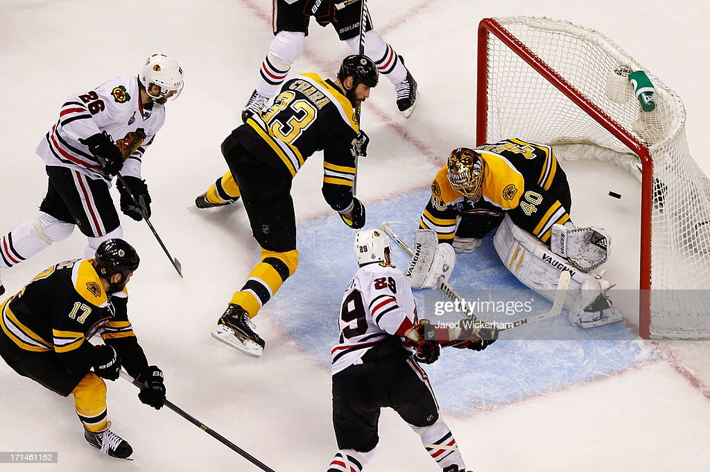 <a gi-track='captionPersonalityLinkClicked' href=/galleries/search?phrase=Bryan+Bickell&family=editorial&specificpeople=241498 ng-click='$event.stopPropagation()'>Bryan Bickell</a> #29 of the Chicago Blackhawks scores a goal in the second period past <a gi-track='captionPersonalityLinkClicked' href=/galleries/search?phrase=Tuukka+Rask&family=editorial&specificpeople=716723 ng-click='$event.stopPropagation()'>Tuukka Rask</a> #40 of the Boston Bruins during Game Six of the Stanley Cup Final on June 24, 2013 at TD Garden in Boston, Massachusetts.