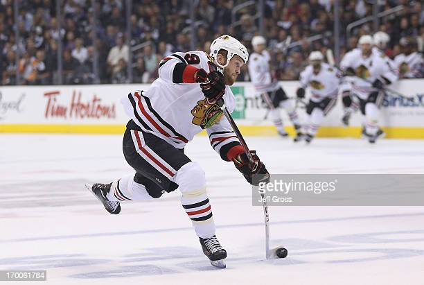 Bryan Bickell of the Chicago Blackhawks shoots the puck from the high slot in the first period of Game Four of the Western Conference Final against...