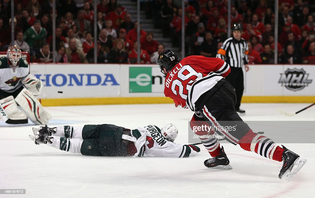 <a gi-track='captionPersonalityLinkClicked' href=/galleries/search?phrase=Bryan+Bickell&family=editorial&specificpeople=241498 ng-click='$event.stopPropagation()'>Bryan Bickell</a> #29 of the Chicago Blackhawks shoots the puck over <a gi-track='captionPersonalityLinkClicked' href=/galleries/search?phrase=Jared+Spurgeon&family=editorial&specificpeople=4594192 ng-click='$event.stopPropagation()'>Jared Spurgeon</a> #46 of the Minnesota Wild to score a third period goal against Ilya Bryzgalov #30 in Game Two of the Second Round of the 2014 NHL Stanley Cup Playoffs at the United Center on May 4, 2014 in Chicago, Illinois. The Blackhawks defeated the Wild 4-1.