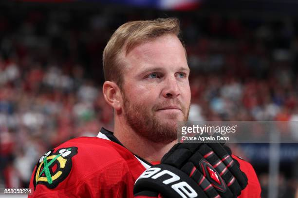 Bryan Bickell of the Chicago Blackhawks stands for the national anthem prior to the game against the Pittsburgh Penguins at the United Center on...