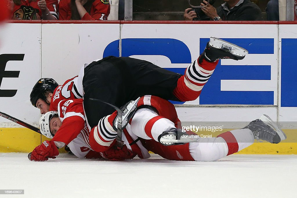 <a gi-track='captionPersonalityLinkClicked' href=/galleries/search?phrase=Bryan+Bickell&family=editorial&specificpeople=241498 ng-click='$event.stopPropagation()'>Bryan Bickell</a> #29 of the Chicago Blackhawks takes down <a gi-track='captionPersonalityLinkClicked' href=/galleries/search?phrase=Niklas+Kronwall&family=editorial&specificpeople=220826 ng-click='$event.stopPropagation()'>Niklas Kronwall</a> #55 of the Detroit Red Wings in Game Seven of the Western Conference Semifinals during the 2013 NHL Stanley Cup Playoffs at the United Center on May 29, 2013 in Chicago, Illinois.