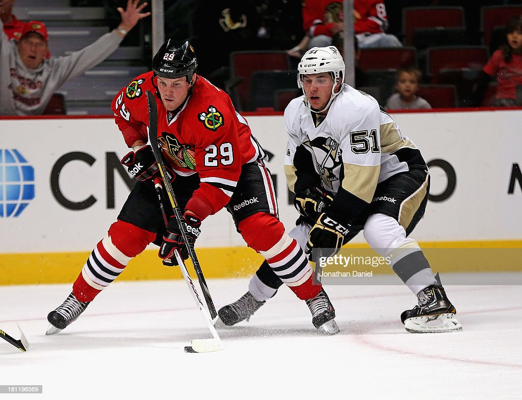 <a gi-track='captionPersonalityLinkClicked' href=/galleries/search?phrase=Bryan+Bickell&family=editorial&specificpeople=241498 ng-click='$event.stopPropagation()'>Bryan Bickell</a> #29 of the Chicago Blackhawks tries to get off a shot after <a gi-track='captionPersonalityLinkClicked' href=/galleries/search?phrase=Derrick+Pouliot&family=editorial&specificpeople=8050720 ng-click='$event.stopPropagation()'>Derrick Pouliot</a> #51 of the Pittsburgh Penguins breaks his stick trying for a block during an exhibition game at United Center on September 19, 2013 in Chicago, Illinois.