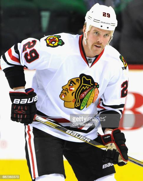 Bryan Bickell of the Chicago Blackhawks warms up before playing in the game against the Calgary Flames at Scotiabank Saddledome on November 20 2014...