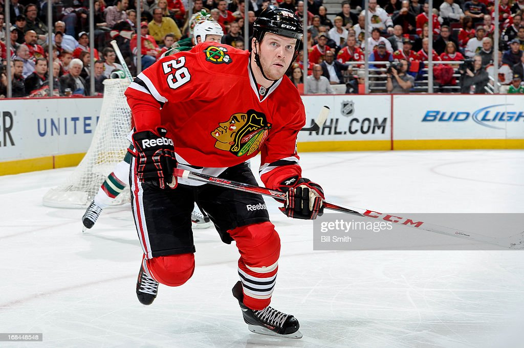 <a gi-track='captionPersonalityLinkClicked' href=/galleries/search?phrase=Bryan+Bickell&family=editorial&specificpeople=241498 ng-click='$event.stopPropagation()'>Bryan Bickell</a> #29 of the Chicago Blackhawks watches for the puck in Game Five of the Western Conference Quarterfinals against the Minnesota Wild during the 2013 Stanley Cup Playoffs at the United Center on May 09, 2013 in Chicago, Illinois.