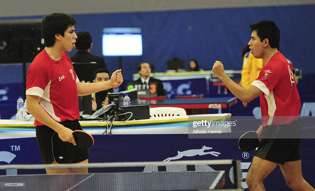 Bryan Blas and Julio Li of Peru celebrate during the match against Alexander Echavarria and Joaquin Villegas of Colombia in men's double table tenis final match as part of the XVII Bolivarian Games Trujillo 2013 at Club Regatas on November 27, 2013 in Lima, Peru.