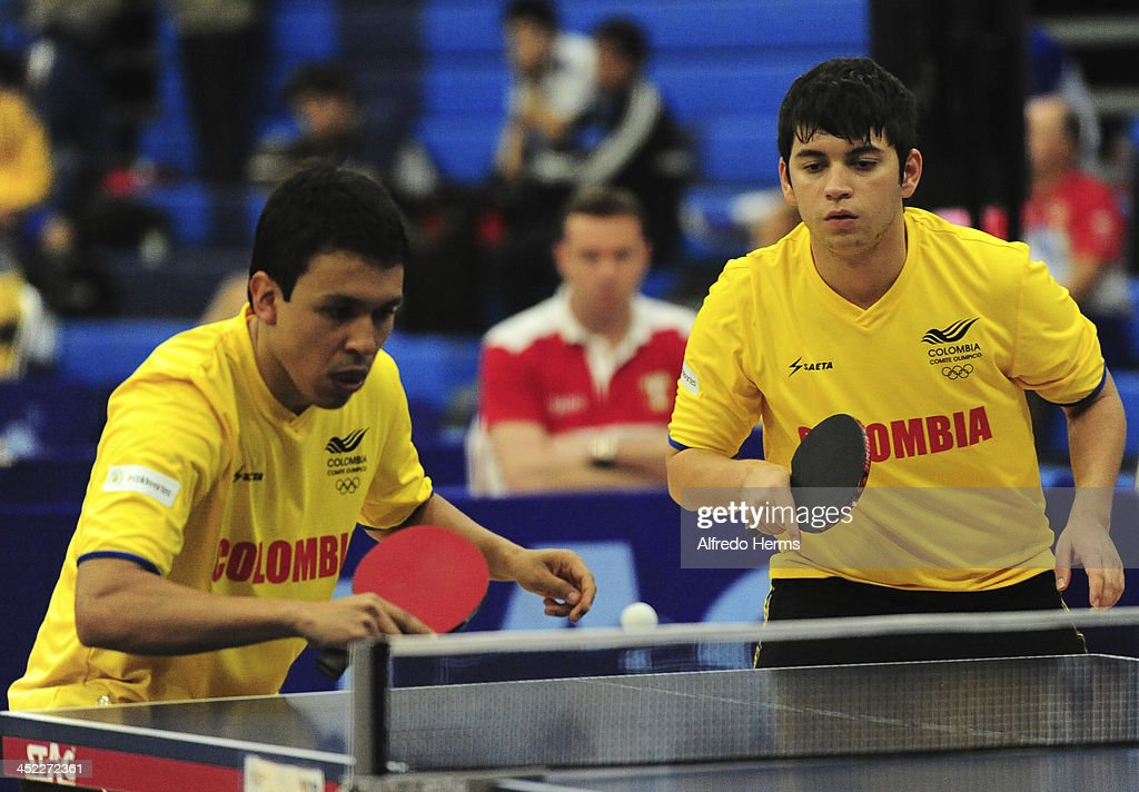 Bryan Blas and Julio Li of Peru compete against Alexander Echavarria and Joaquin Villegas of Colombia in men's double table tenis final match as part of the XVII Bolivarian Games Trujillo 2013 at Club Regatas on November 27, 2013 in Lima, Peru.