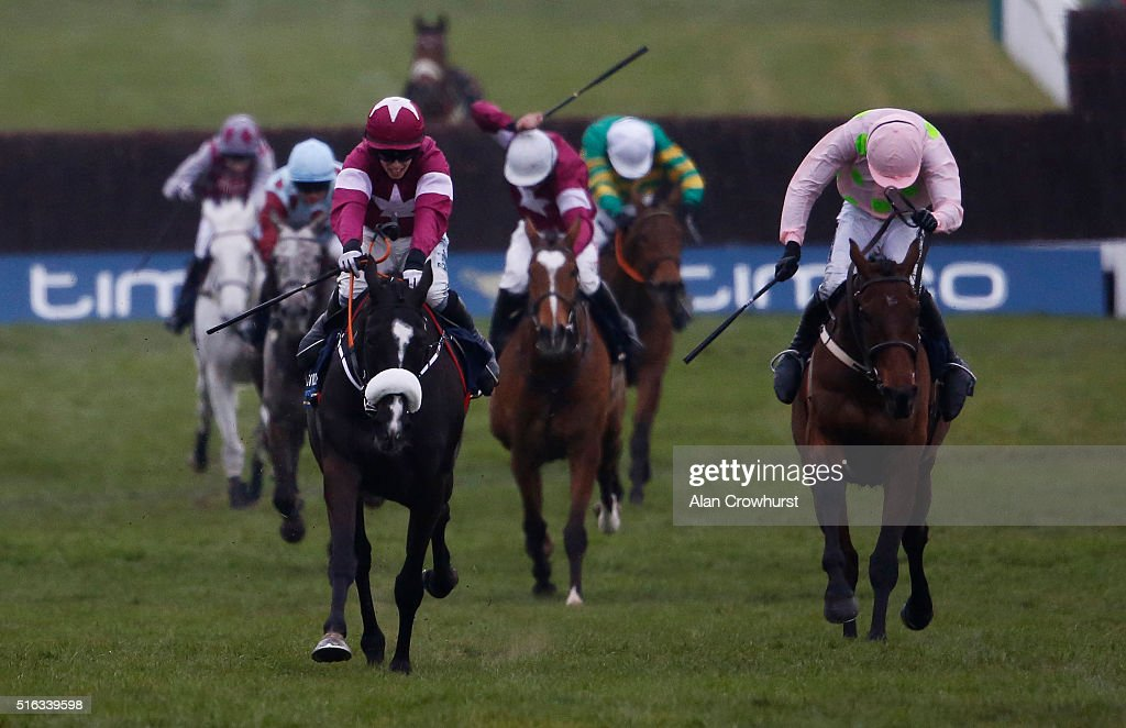 Bryan Cooper riding Don Cossack (C, maroon) win The Timico Cheltenham Gold Cup Steeple Chase from Djakadam and Ruby Walsh (R) during the Gold Cup Day of Cheltenham Festival at Cheltenham racecourse on March 18, 2016 in Cheltenham, England.
