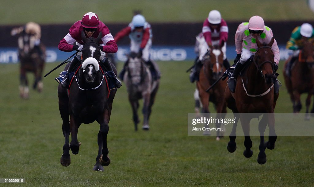 Bryan Cooper riding Don Cossack (L, maroon) win The Timico Cheltenham Gold Cup Steeple Chase during the Gold Cup Day of Cheltenham Festival at Cheltenham racecourse on March 18, 2016 in Cheltenham, England.
