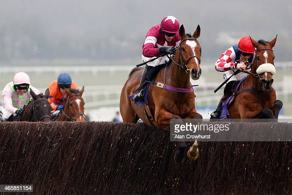 Bryan Cooper riding Don Poli clear the last to win The RSA Steeple Chase at Cheltenham racecourse on March 11 2015 in Cheltenham England