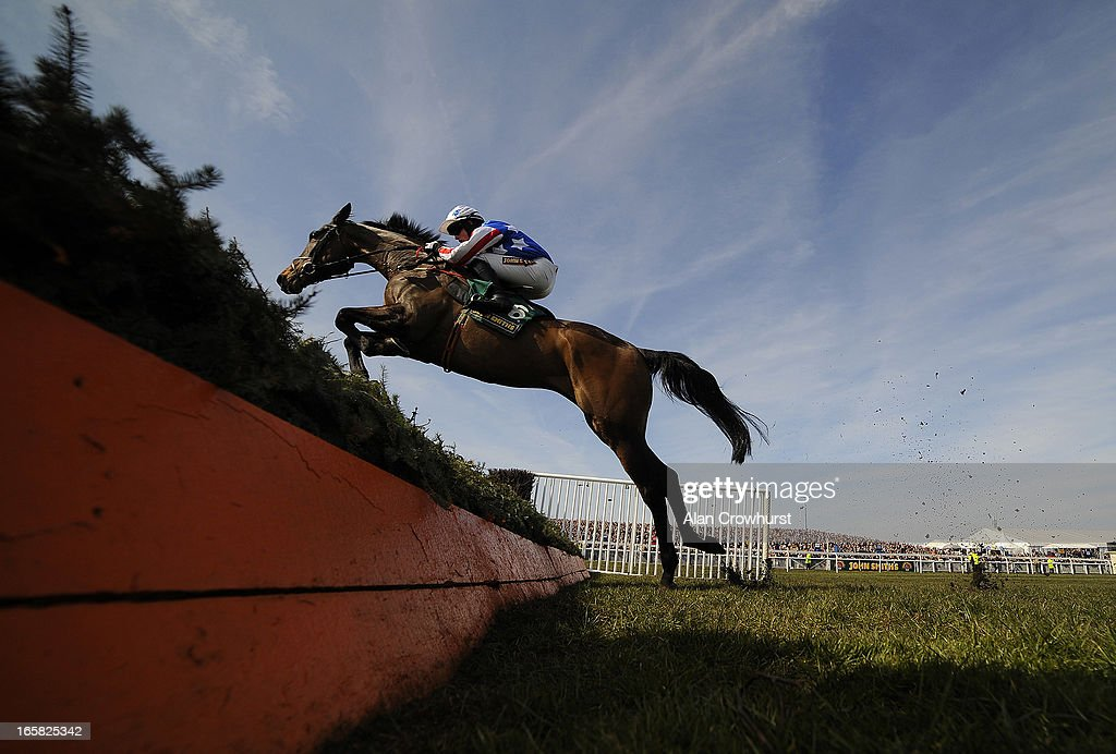 Bryan Cooper riding Special Tiara on their way to winning The John Smith's Maghull Novices' Steeple Chase at Aintree racecourse on April 06, 2013 in Liverpool, England.