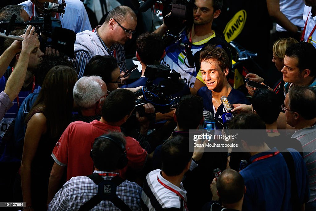 <a gi-track='captionPersonalityLinkClicked' href=/galleries/search?phrase=Bryan+Coquard&family=editorial&specificpeople=8795501 ng-click='$event.stopPropagation()'>Bryan Coquard</a> and <a gi-track='captionPersonalityLinkClicked' href=/galleries/search?phrase=Morgan+Kneisky&family=editorial&specificpeople=5778074 ng-click='$event.stopPropagation()'>Morgan Kneisky</a> (hidden behind cameras) are surrounded by the French media after they compete and win the gold medal and world championship in the Mens Madison race during day 5 of the UCI Track Cycling World Championships held at National Velodrome on February 22, 2015 in Paris, France.