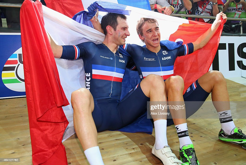 <a gi-track='captionPersonalityLinkClicked' href=/galleries/search?phrase=Bryan+Coquard&family=editorial&specificpeople=8795501 ng-click='$event.stopPropagation()'>Bryan Coquard</a> and <a gi-track='captionPersonalityLinkClicked' href=/galleries/search?phrase=Morgan+Kneisky&family=editorial&specificpeople=5778074 ng-click='$event.stopPropagation()'>Morgan Kneisky</a> of France celebrate winning the gold medal in the Men's Madison Final during Day Five of the UCI Track Cycling World Championships at the National Velodrome on February 22, 2015 in Paris, France.