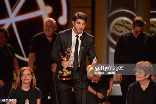 Bryan Craig accepts the award for outstanding younger actor in a drama series for 'General Hospital' with the dogs of DaphneyLand Basset Rescue and...