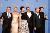 Bryan Cranston Anna Gunn Betsy Brandt Vince Gilligan Aaron Paul and RJ Mitte pose in the press room during the 71st Annual Golden Globe Awards held...