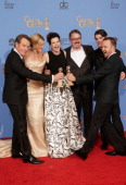 Bryan Cranston Anna Gunn Betsy Brandt Vince Gilligan RJ Mitte and Aaron Paul pose in the press room during the 71st Annual Golden Globe Awards held...