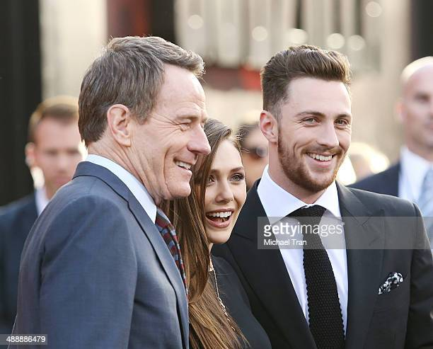Bryan Cranston Elizabeth Olsen and Aaron TaylorJohnson arrive at the Los Angeles premiere of 'Godzilla' held at Dolby Theatre on May 8 2014 in...