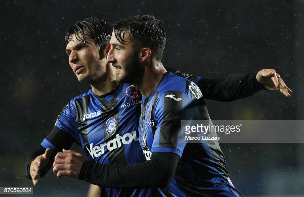 Bryan Cristante of Atalanta BC celebrates with his teammate Marten De Roon after scoring the opening goal during the Serie A match between Atalanta...