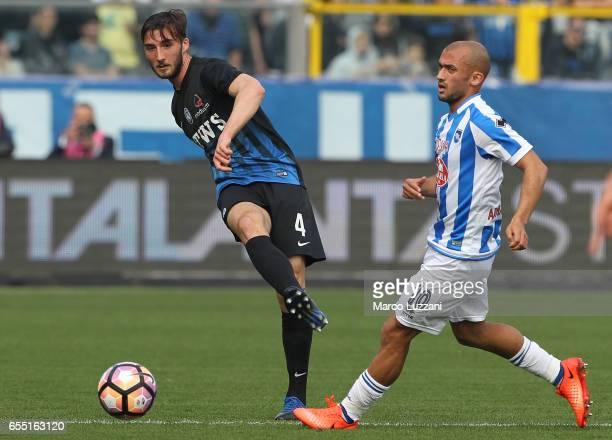 Bryan Cristante of Atalanta BC cis challenged by Ahmed Benali of Pescara Calcio during the Serie A match between Atalanta BC and Pescara Calcio at...