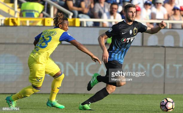 Bryan Cristante of Atalanta BC is challenged by Samuel Bastien of AC Chievo Verona during the Serie A match between Atalanta BC and AC Chievo Verona...