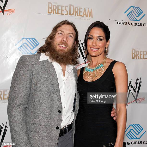 Bryan Danielson aka Daniel Bryan and Brie Bella attend WWE's 2014 SuperStars For Kids at the New Orleans Museum of Art on April 3 2014 in New Orleans...