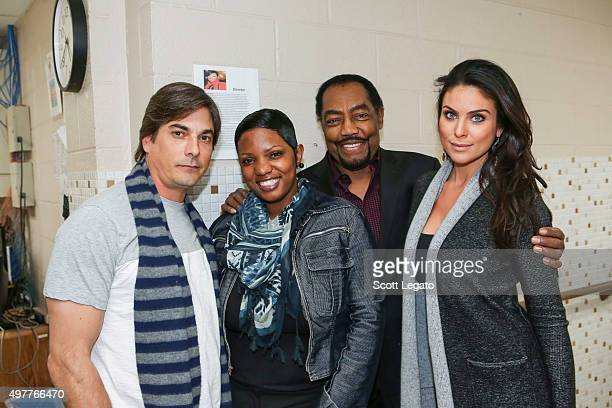 Bryan Dattilo Director Kisha Woods James Reynolds and Nadia Bjorlin pose after receiving donations by Days of Our Lives daytime television drama at...